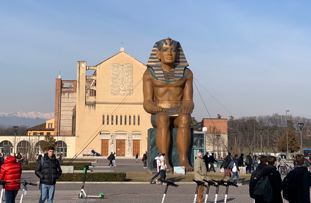Giant statue of an Egyptian pharaoh, located outside the train station in Verona