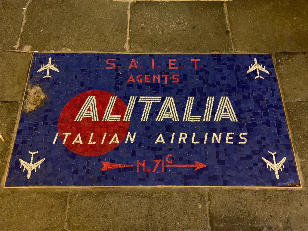 Alitalia airlines mosaic embedded in the street, Venice