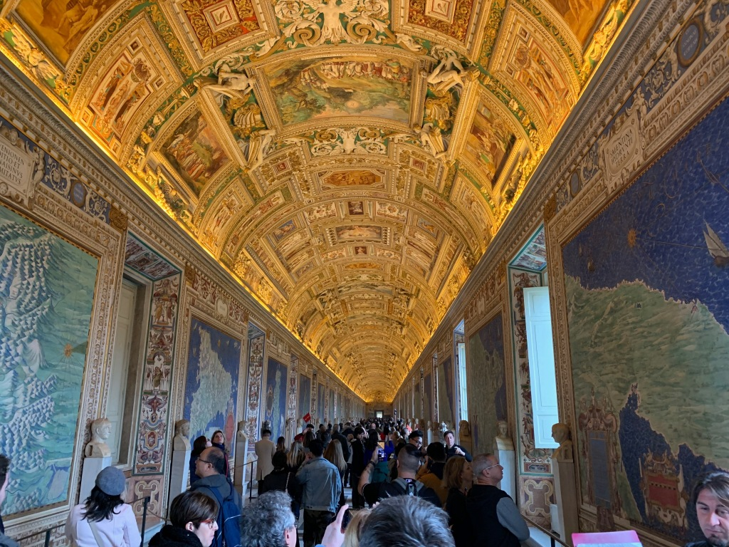 View of the Vatican's Gallery of Maps with tourists