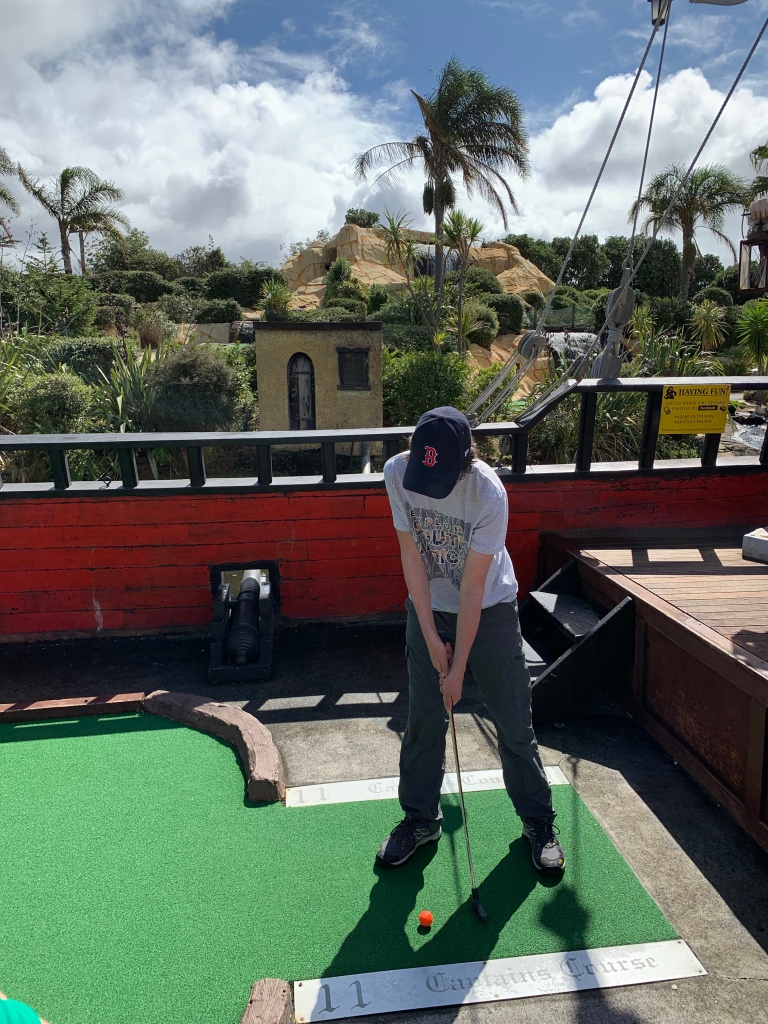 Putting at the Treasure Island mini golf course in Auckland