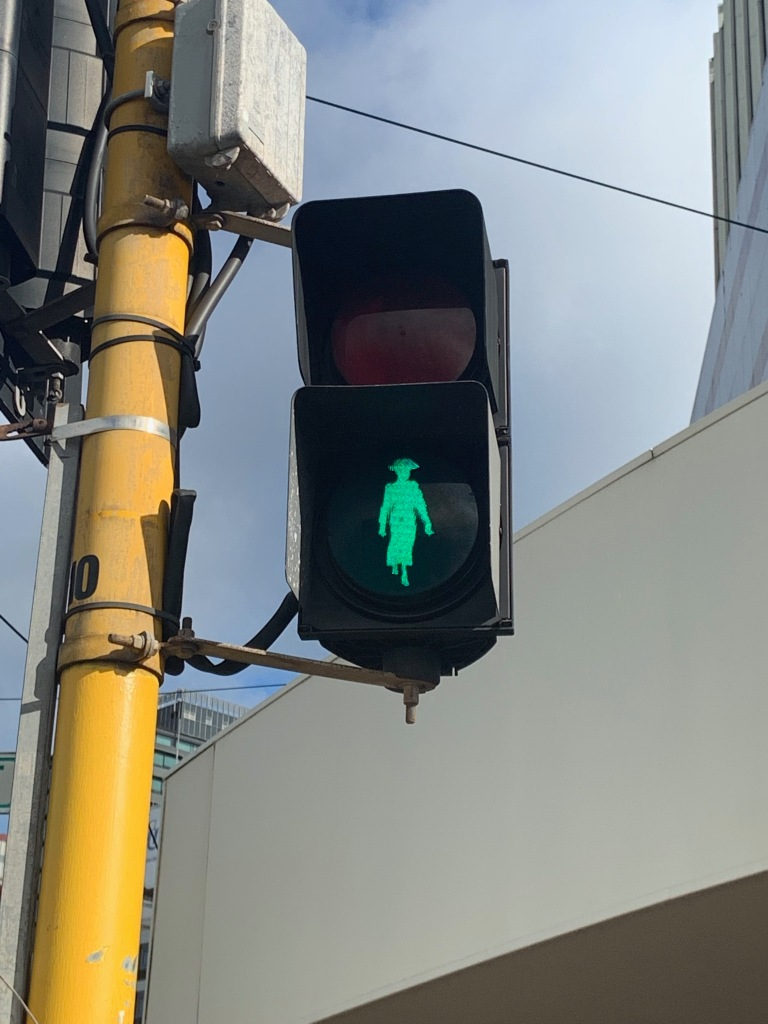 Walk sign in Wellington, with the silhouette of Kate Sheppard